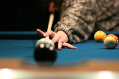 Winning shot. Shooting the eight ball in Royalty Free Stock Image