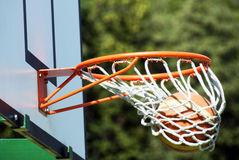 Winning shot - basketball. A basketball through the hoop stock images