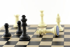 Winning Strategy. Chess Pieces on a board showing the King. The shot can be a business metaphor relating to a winning strategy or leadership. Main focus is on royalty free stock photography
