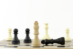 Winning Strategy. Chess Pieces on a board showing the King. The shot can be a business metaphor relating to a winning strategy or leadership. Main focus is on stock photos