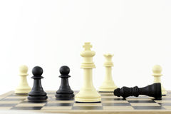 Winning Strategy. Chess Pieces on a board showing the King. The shot can be a business metaphor relating to a winning strategy or leadership. Main focus is on stock images