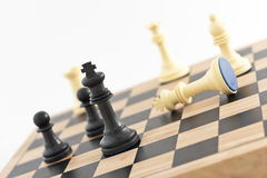 Winning Strategy. Chess Pieces on a board showing the King. The shot can be a business metaphor relating to a winning strategy or leadership. Main focus is on Royalty Free Stock Image