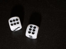 Winning streak. Dice showing number 6 on black textured bacgroun Royalty Free Stock Images