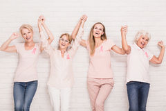 Winning the struggle. Group of happy women winning the struggle with breast cancer Stock Photos