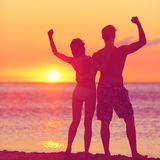 Winning success concept - happy beach couple stock photography