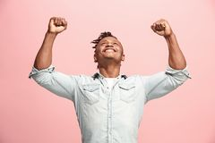 Winning success man happy ecstatic celebrating being a winner. Dynamic energetic image of male model. I won. Winning success happy man celebrating being a winner Stock Photo