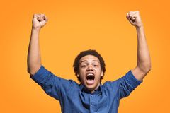 Winning success man happy ecstatic celebrating being a winner. Dynamic energetic image of male model. I won. Winning success happy man celebrating being a winner Stock Image