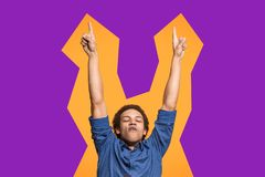 Winning success man happy ecstatic celebrating being a winner. Dynamic energetic image of male model stock images