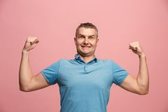Winning success man happy ecstatic celebrating being a winner. Dynamic energetic image of male model. I won. Winning success happy man celebrating being a winner Royalty Free Stock Photo