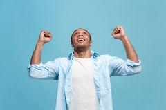 Winning success man happy ecstatic celebrating being a winner. Dynamic energetic image of male model. I won. Winning success happy man celebrating being a winner Royalty Free Stock Photography