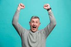 Winning success man happy ecstatic celebrating being a winner. Dynamic energetic image of male model. I won. Winning success happy man celebrating being a winner Royalty Free Stock Image