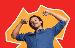 Winning success man happy ecstatic celebrating being a winner. Dynamic energetic image of male model stock photography