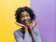 Winning success woman happy ecstatic celebrating being a winner. Dynamic energetic image of female afro model royalty free stock image