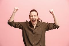Winning success woman happy ecstatic celebrating being a winner. Dynamic energetic image of female model Royalty Free Stock Photo