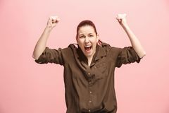 Winning success woman happy ecstatic celebrating being a winner. Dynamic energetic image of female model Royalty Free Stock Photos
