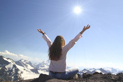 Winning success woman happy with her hands raised above the head Royalty Free Stock Image