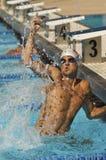 Winning Swimmer. Winning male Swimmer in outdoor pool Stock Photo