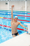 Winning Swimmer Young muscular preparing Royalty Free Stock Photo