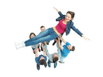 Winning team rejoice in victory and throws the leader up Royalty Free Stock Photo