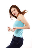 Winning teen girl happy ecstatic gesturing success. Isolated on white background Royalty Free Stock Photography