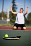 Winning tennis player. A happy tennis player in joy after winning Stock Image