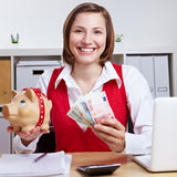 Winning woman with piggy bank Royalty Free Stock Photos