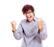 Winning young man. Happy guy screaming with raised fists. Isolated on white background, mask included Royalty Free Stock Image
