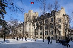 WINNIPEG, CANADA - 2014-11-19: Students moving towards Tier Building, University of Manitoba, Winnipeg, Manitoba, Canada royalty free stock photography