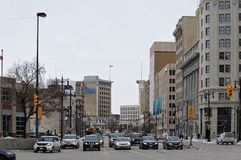 WINNIPEG, CANADA - 2014-11-17: Traffic on Portage at Main junction looking northward on Main st. Route 85, also known as. Portage Avenue, is a major route in royalty free stock photo