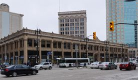 WINNIPEG, MB, CANADA - 2014-11-17: Traffic on Portage avenue in front of historical Curry Building. Route 85, also known. As Portage Avenue, is a major route in stock images