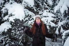 Winnter girl and snow fir tree. Stock Photos