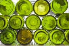 Wino butelki przed lekkim tłem Zdjęcia Stock