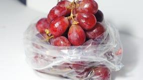 Winogrona w palstic torbie Obraz Royalty Free