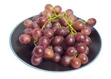 Winogrono w czarnym talerzu Fotografia Royalty Free