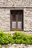 Winow with curtain on old stone house Stock Photos