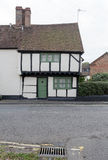 Winslow, Buckinghamshire, United Kingdom, October 25, 2016: Cottage on Horn street with green door on grey chilly morning. royalty free stock photography