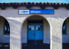 Winslow train station. Amtrak station at La Posada resort in Winslow, Arizona. Blue doors, white arches. Historic. Fred Harvey House Royalty Free Stock Photos