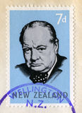 Winston Churchill Postage Stamp New Zealand. NEW ZEALAND - CIRCA 1965: A vintage New Zealand postage stamp celebrating the life of Sir Winston Churchill, circa Stock Image