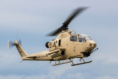 Winston-Salem, NC - Circa September 2014 - An AH-1 Cobra gunship. An AH-1 Cobra gunship hovering over the ground.  Armed with 2.5 inch rockets and a chain gun Stock Image