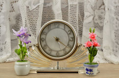 Wintage clock with flowers Stock Images