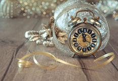 Wintage clock set on five to twelve with golden decorations Royalty Free Stock Image