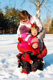 Winter. Family playing in a winter park Royalty Free Stock Photos