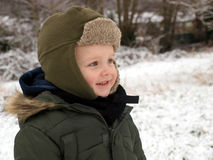Winter. Little child very happu about snow outsite royalty free stock image