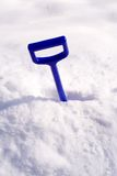 Winter. Blue shovel in white snow Royalty Free Stock Photos