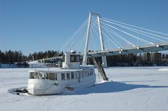 Winter. Boat on a frozen river in Umea north of Sweden royalty free stock photos