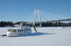 Winter. Boat on a frozen river in Umea north of Sweden stock photos