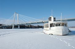 Winter. Boat on the frozen river in Ume嬠North of Sweden stock photo