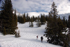 Winter. Two people snowshoeing in the Alps Stock Image