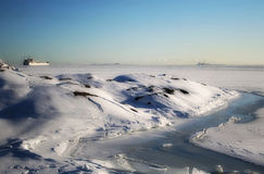 Winter. A ship on the  frozen sea. Finland Royalty Free Stock Photography
