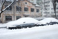 Winter. Snowflakes. Cars under snow Stock Photos